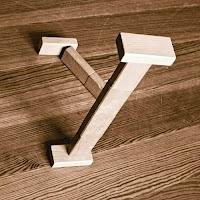 Takozlardan yapılmış Y harfi