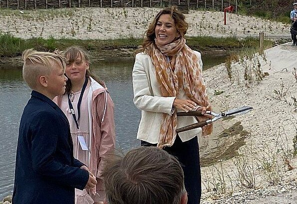 Crown Princess Mary wore Chanel black and cream espadrilles flats. Princess wore an ivory blazer and navy trousers