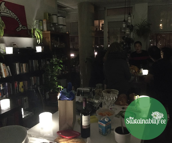 Friends together and talk in a room being lit by solar lamps during Earth Hour