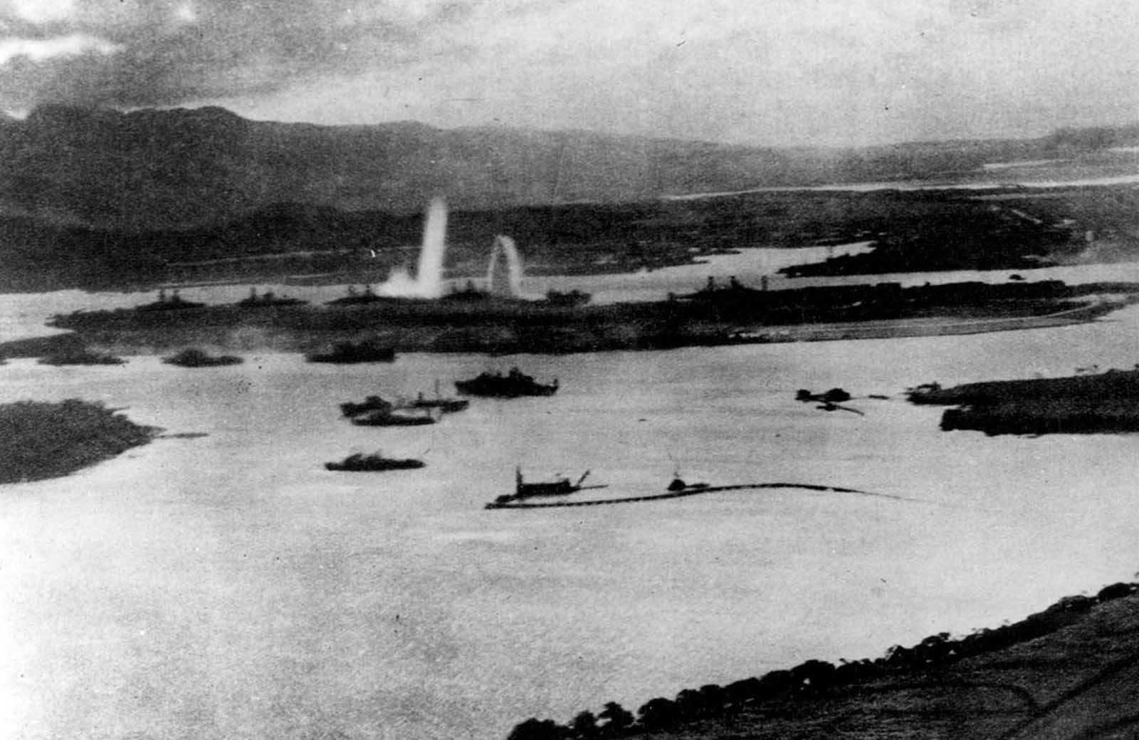 Aerial view of the initial blows struck against American ships, as seen from a Japanese plane over Pearl Harbor.