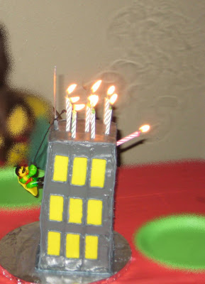 Robin Climbing Building Cake - Candles Lit