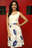 Actress Ritu Varma Stills in White Floral Short Dress at Kesava Movie Success Meet .COM 0034.JPG