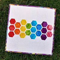 http://www.sliceofpiquilts.com/2018/10/rainbow-hexies.html