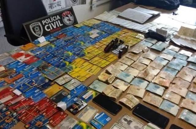 Suspeito de 'agiotagem' é preso com R$ 56 mil e 138 cartões, na Paraíba