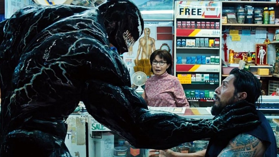 Venom choking bad guy