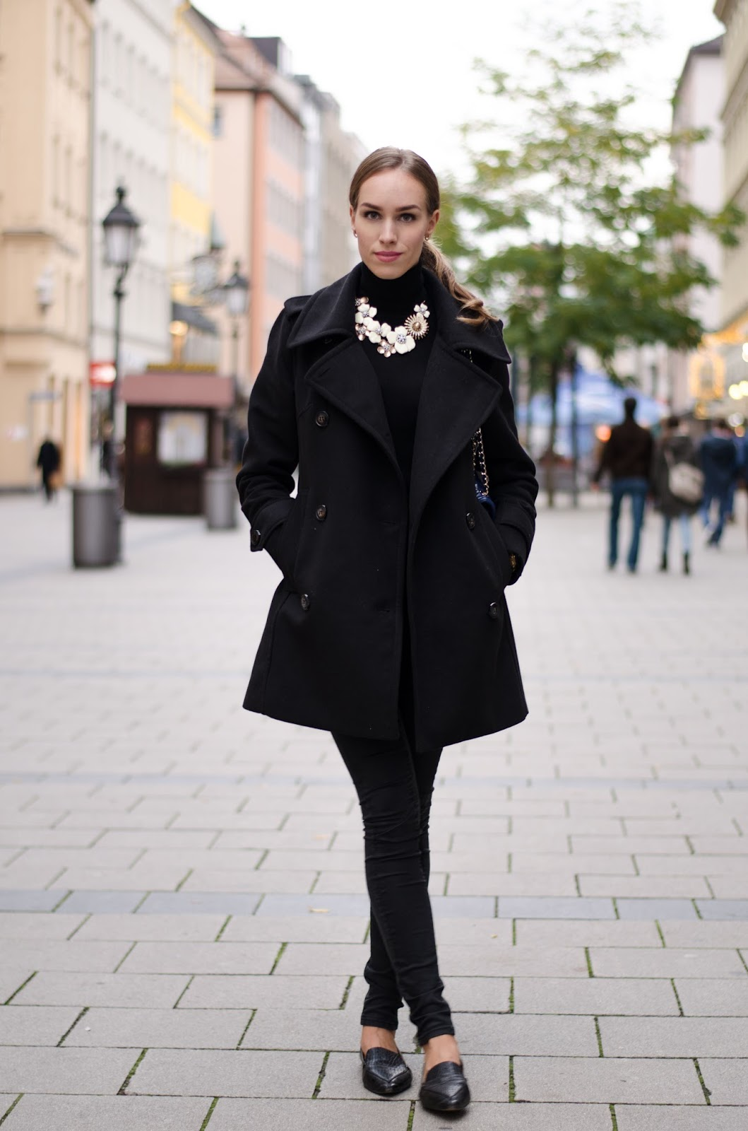 kristjaana mere black fall outfit pea coat jumper jeans flats statement necklace
