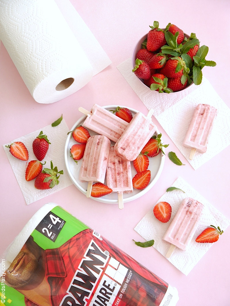 Strawberries and Cream Popsicles Recipe - an easy, delicious dessert using fresh strawberries that's perfect for warmer days or a summer party! by BirdsParty.com #popsicles #icecream #strawberriescream #popsiclerecipe #strawberryrecipe #icepops #icelollies