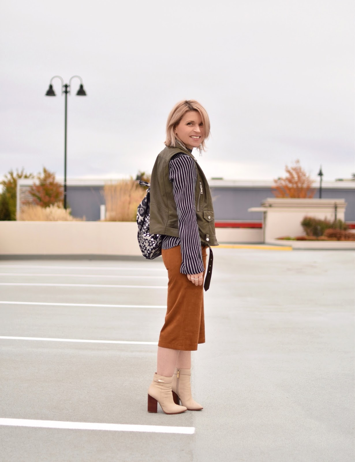 Outfit inspiration c/o Monika Faulkner - striped blouse, faux-suede culottes, moto vest, and ivory booties