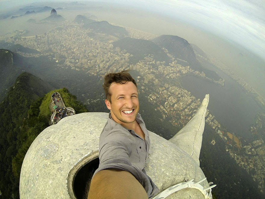 Meet Lee Thompson, a travel company boss who has captured what could be the ultimate selfie after photographing himself at the top of Brazil's iconic Christ The Redeemer statue. - Can You Tell Where This Guy Is? Because He Just Shattered The Record For Craziest Selfie Ever.