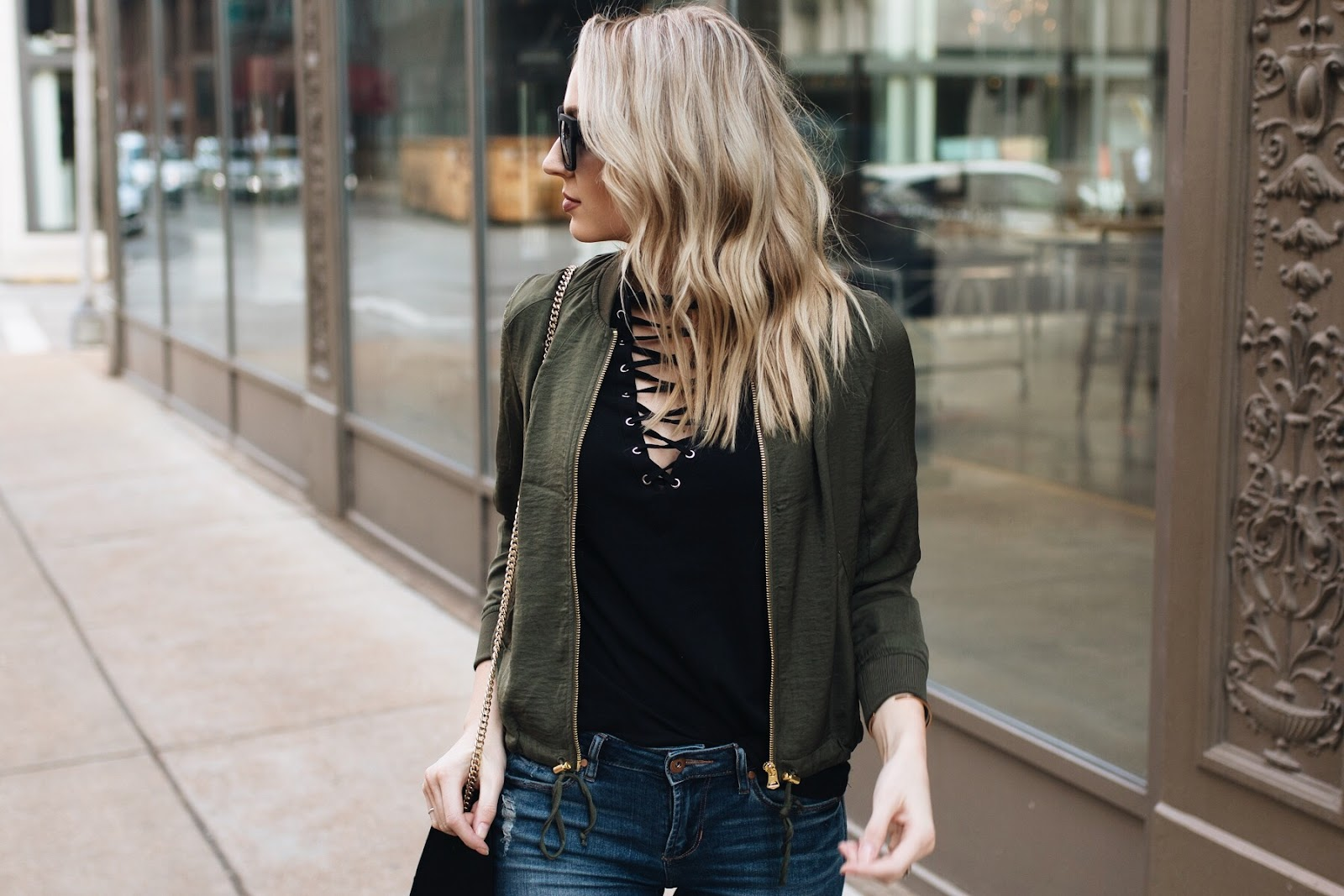 layered with a lace-up tee