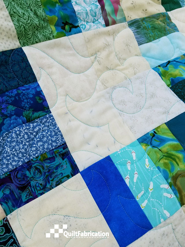 Happy Times pantograph on Sea Glass quilt