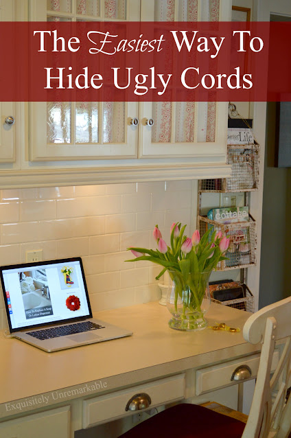 The Easiest Way To Hide Messy Cords text over a photo of a cottage style desk area