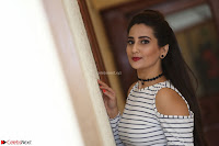 Manjusha in sleevelss crop top and black skirt at Darshakudu pre release ~  Exclusive Celebrities Galleries 028.JPG