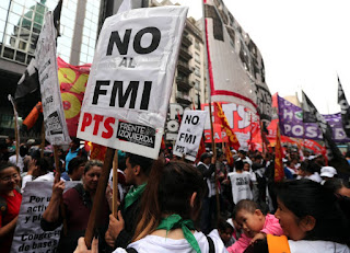 Argentine unions vow further strikes to block pact with IMF