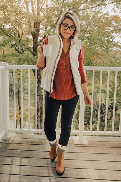19 Preppy Fall Inspired Outfits to Try this Season | The North Face Vest Coat + Henley Shirt + Skinny Pants + Boots