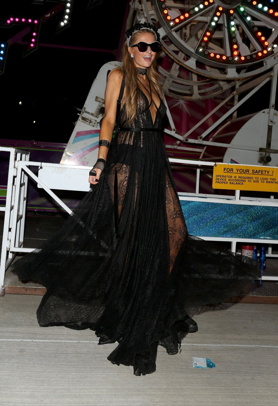 Hilton goes bra-less in sheer lacy black dress attending Neon Carnival at Coachella