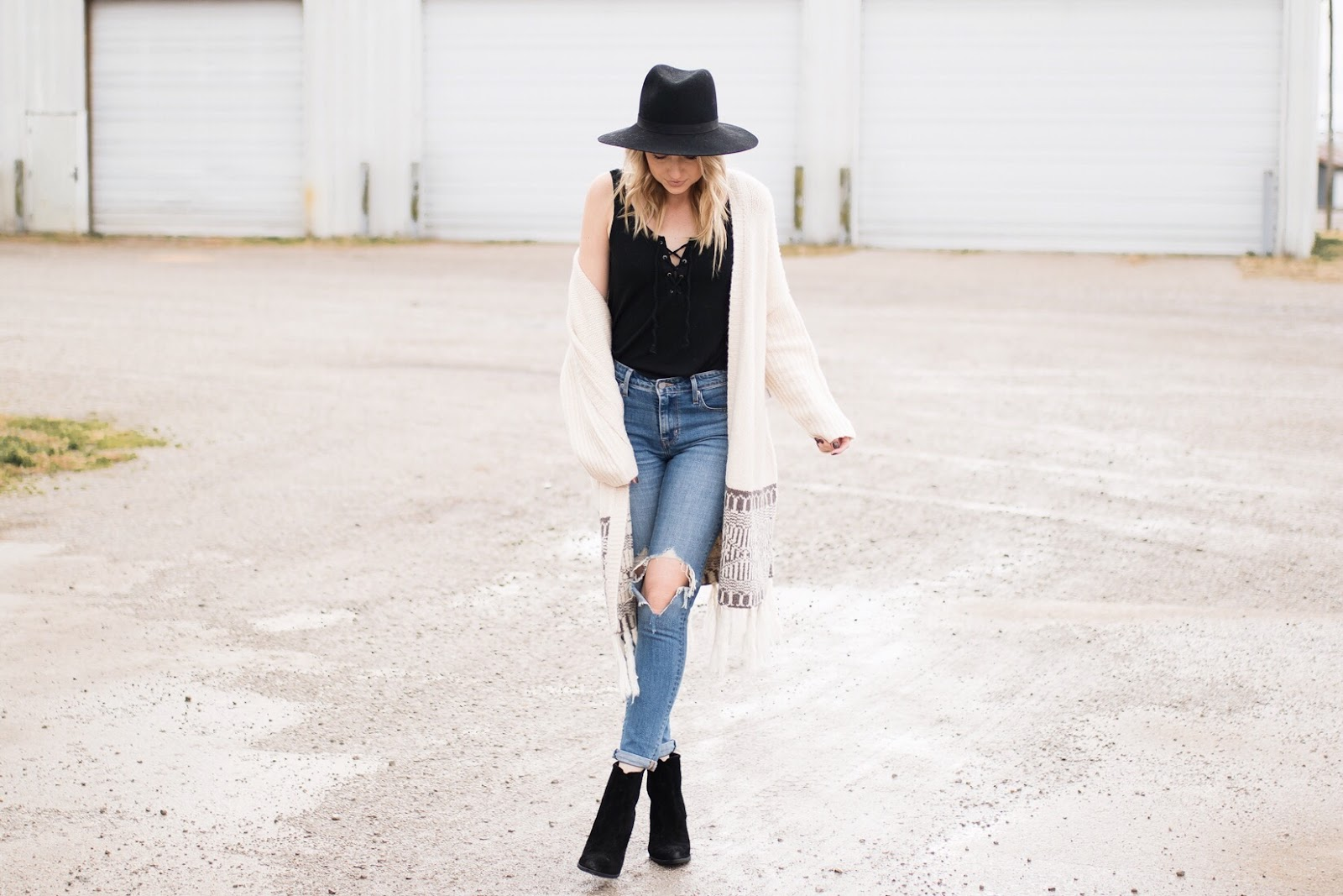 distressed high-waisted jeans with a boho outfit