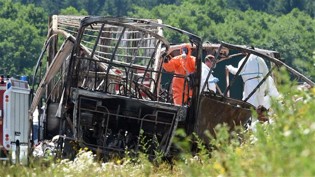 Tour bus carrying pensioners collides with truck, killing 18 in Germany's Bavaria