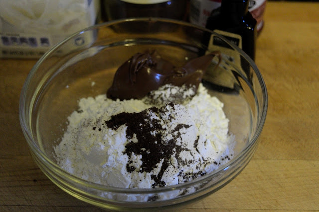 The chocolate hazelnut spread being added to the sugar.