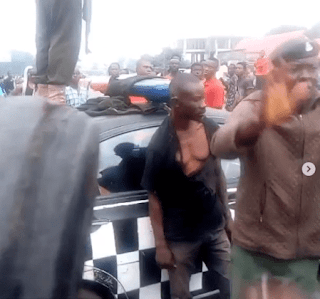 VIDEO: Police Rescue Man From Being Lynched After He Stabbed A Girl To Death In Owerri