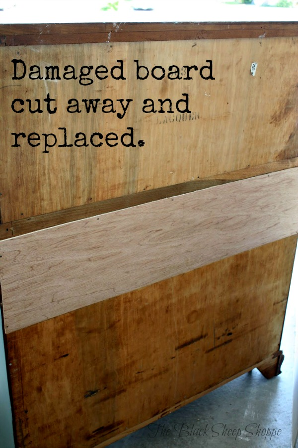 The damaged section of the back of the dresser was cut away and replaced.