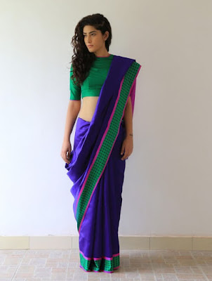 The handwoven silk saree with simple blouse design portrays elegance and grace.