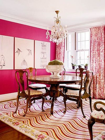 glamorous dining room with hot pink wall