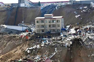 Two residential buildings and a public bathhouse collapsed in the landslide.