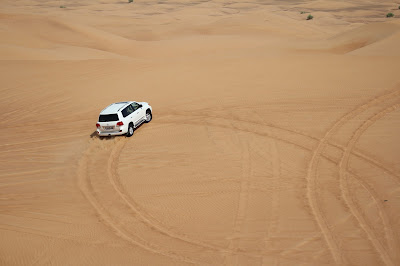 godubaidesertsafari landcruiser doing dune bashing in al aweer desert