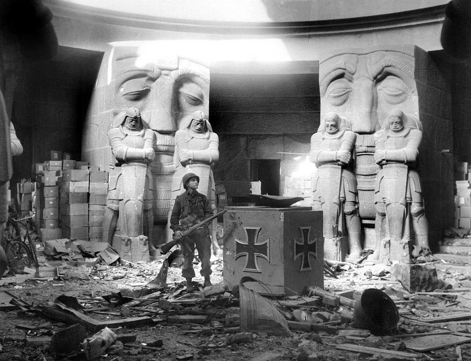 A U.S. soldier stands in the middle of rubble in the Monument of the Battle of the Nations in Leipzig after they attacked the city on April 18, 1945. The huge monument commemorating the defeat of Napoleon in 1813 was one of the last strongholds in the city to surrender. One hundred and fifty SS fanatics with ammunition and foodstuffs stored in the structure to last three months dug themselves in and were determined to hold out as long as their supplies would allow. American First Army artillery eventually blasted the SS troops into surrender.