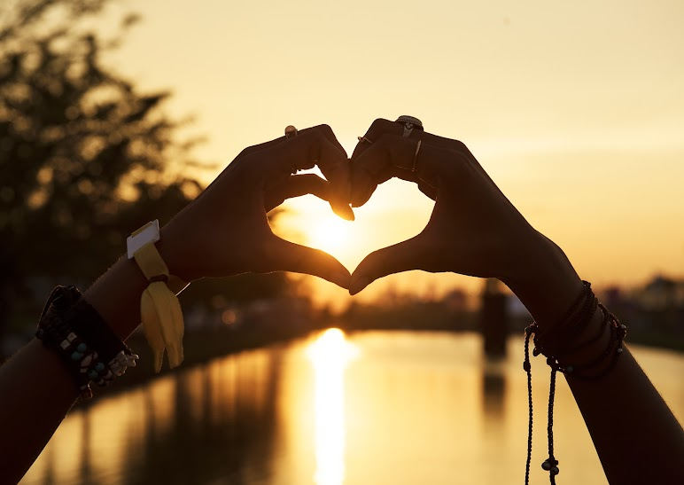 Love By Hands On Sunset