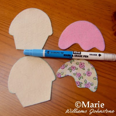 Water soluble fabric marker pen and cut shapes of felt and fabric