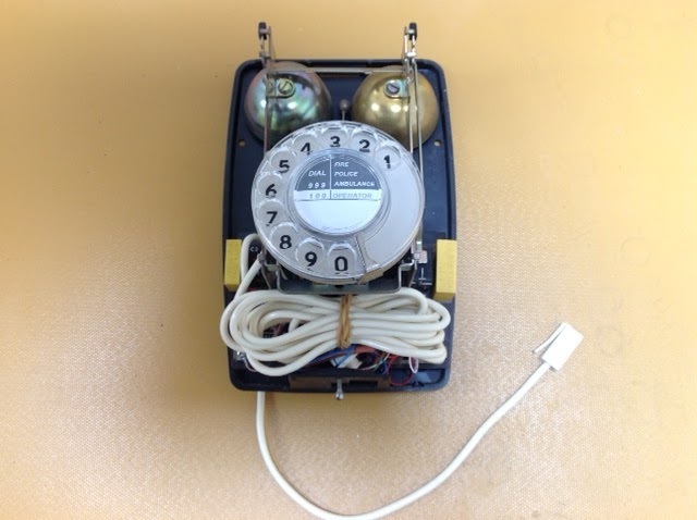 these vintage wall telephones (711 or 741) have sufficient extra space  inside them to store the spare telephone cable safely  see the picture  below