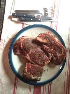 a plate of steaks ready to be grilled!