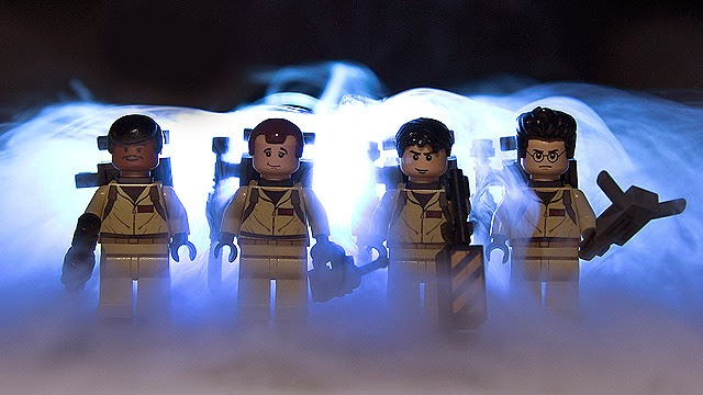 Ghost Hunters in smoke with weapons Leghostbusters