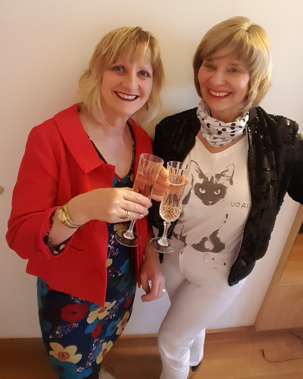 Bloggers and former flatmates Maddie Grigg and Gail Hanlon raise a glass before the Holy Holy Ziggy Stardust gig in London