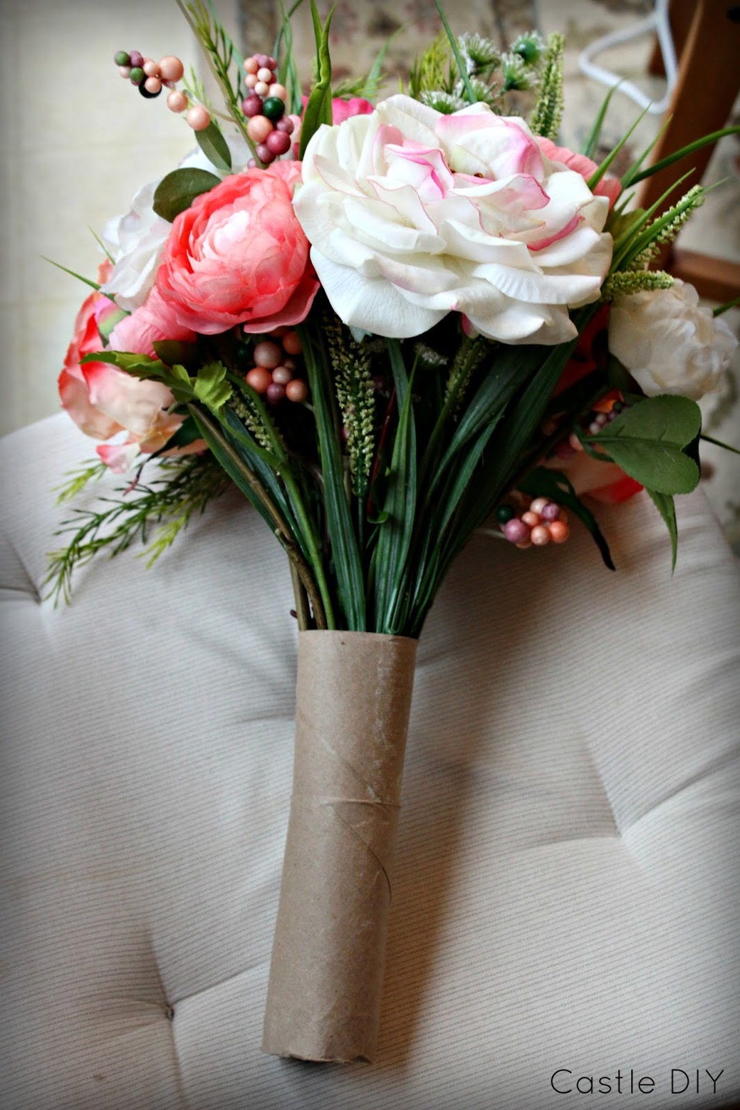 Castle diy faux flower bouquet for the cheap lazy bride i then cut a small strip of ribbon and glued it to the base of the stems along the bottom so that the ends of the stems could not be seen izmirmasajfo