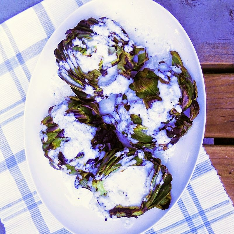 Grilled Artichokes with Lemon Garlic Sauce from www.bobbiskozykitchen.com