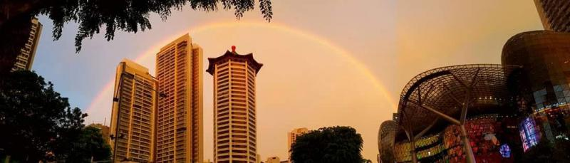 Stunning double rainbow decorated Singapore evening sky