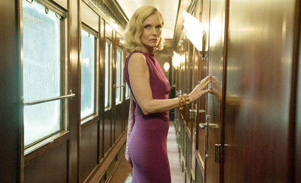 Michelle Pfeiffer plays Caroline Hubbard in MURDER ON THE ORIENT EXPRESS (2017)