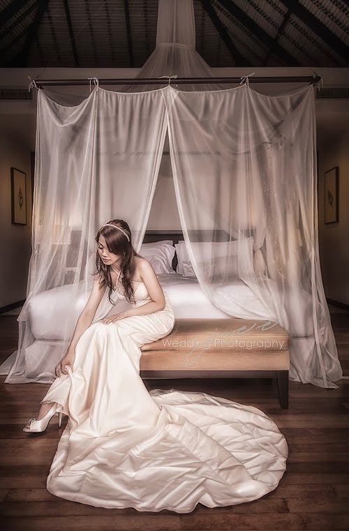post editing done on bride sitting on bed