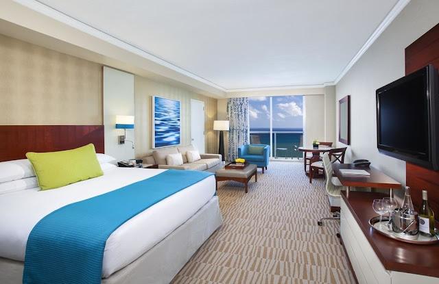 Trump International Beach Resort Miami rises as a striking landmark to luxury amidst the beautiful white sands of Miami Beach.