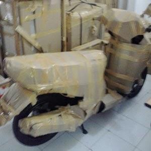 Jasa packing sepeda motor.