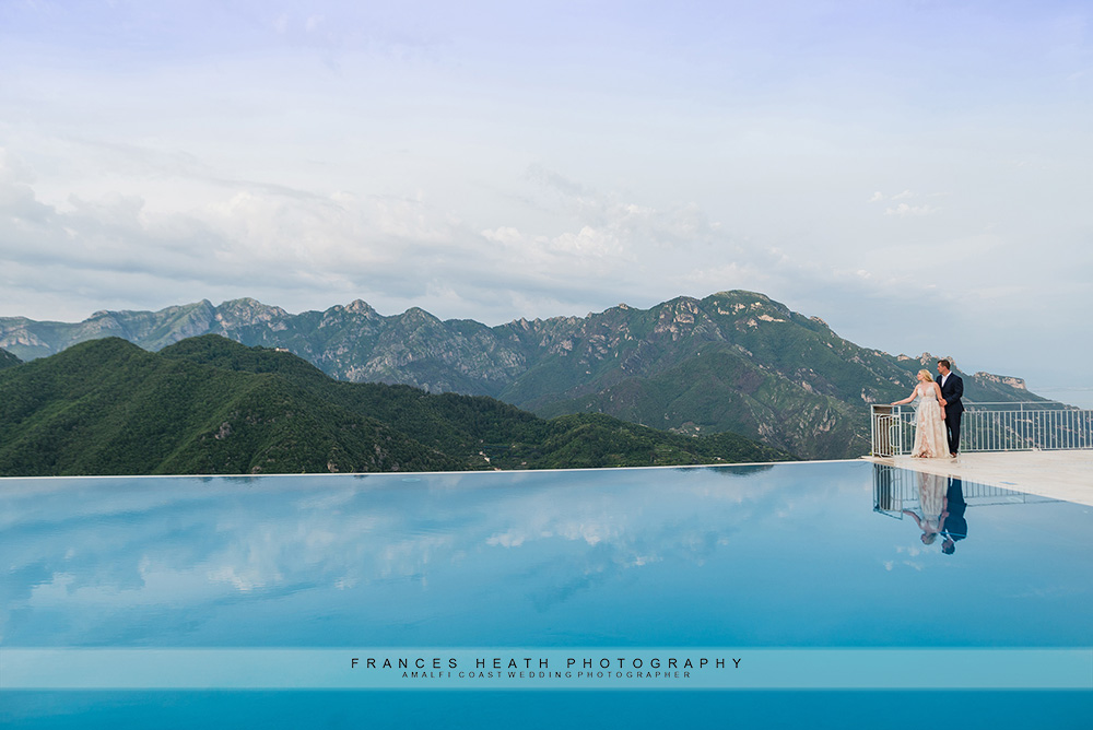 Bride and groom at Caruso infinity pool
