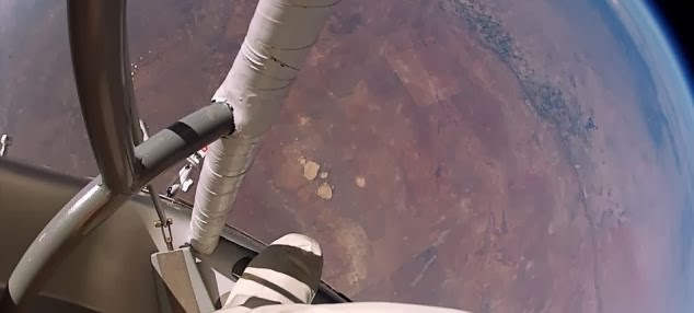 A helmet mounted camera looking down from the capsule - What it's REALLY like to jump from space - New footage of Felix Baumgartner's jump