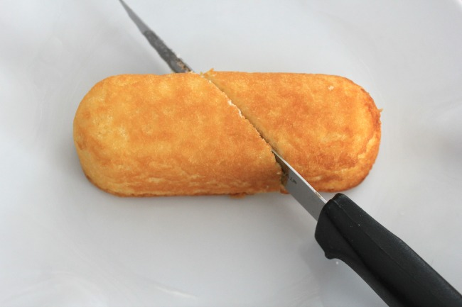 A Twinkie cut on the diagonal with a knife.