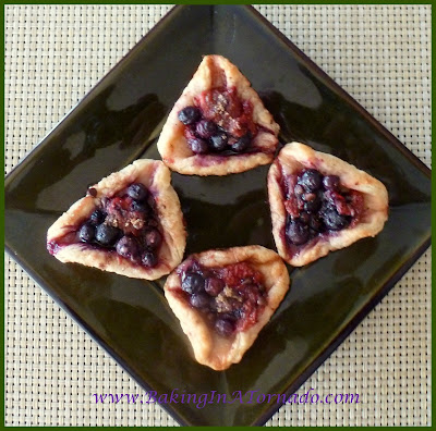 Chocolate Berry Cream Cheese Hamentashen | www.BakingInATornado.com | #recipe #cookies
