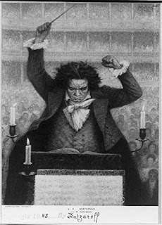 Beethoven conducting from a podium.