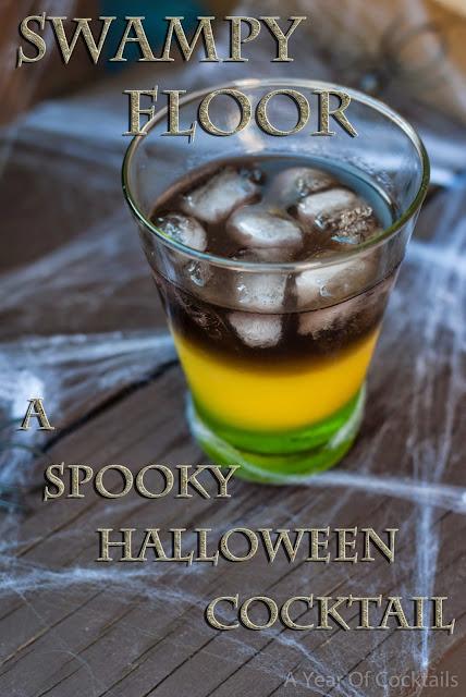 Halloween cocktail, black vodka, midori, melon liqueur, layered cocktail