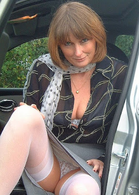 Older woman sitting in car exposing her white panties